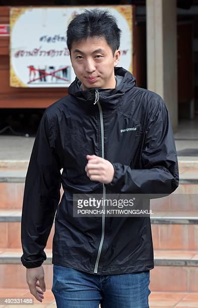Hong Kong photojournalist Anthony Kwan Hokchun walks as he arrives at Samut Prakarn provincial court on October 12 2015 The Hong Kong photographer...