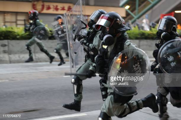Hong Kong police advance on protesters during a demonstration in the Sham Shui Po area in Hong Kong on October 1 as the city observes the National...