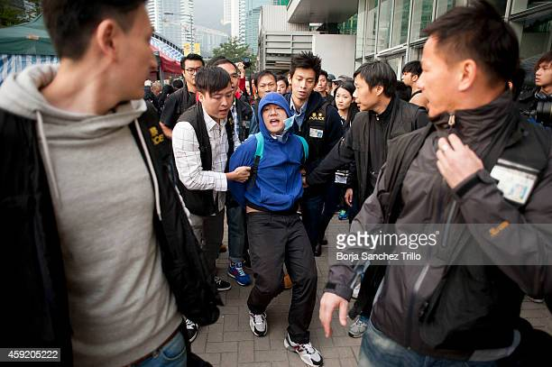 Hong Kong police arrest a Prodemocracy Occupy Central protester outside the Legislative Council building on November 19 2014 in Hong Kong Hong Kong...