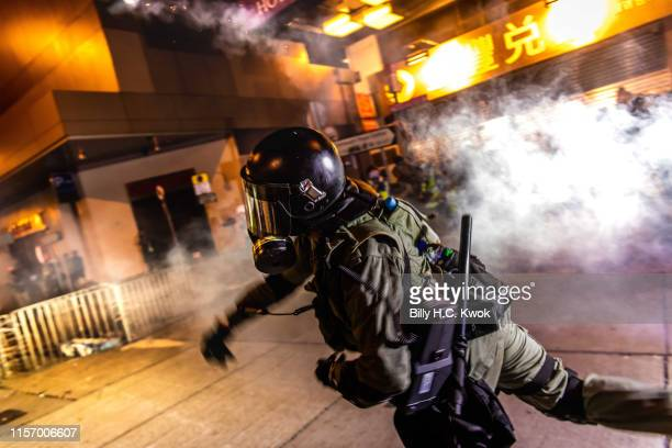 Hong Kong Police clear the street with tear gas during an antiextradition bill march in Hong Kong on July 21 2019 in Hong Kong Hong Kong Prodemocracy...