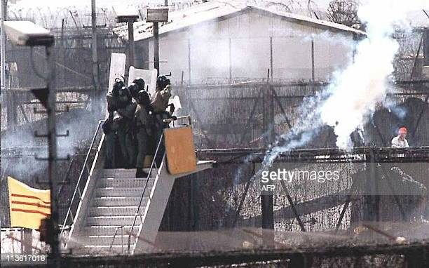Hong Kong police fire tear gas into the Whitehead Detention Centre 20 May to disperse the hundreds of Vietnamese boat people protesting their...