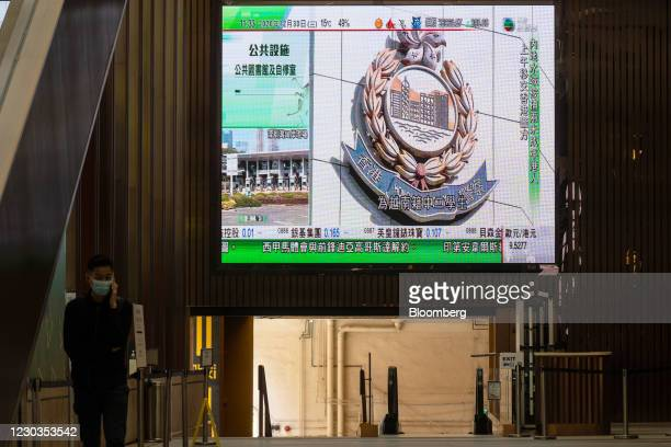 Hong Kong Police Force badge during a news report on China's jailing of 10 Hong Kong activists for illegal border-crossing is shown on a public...