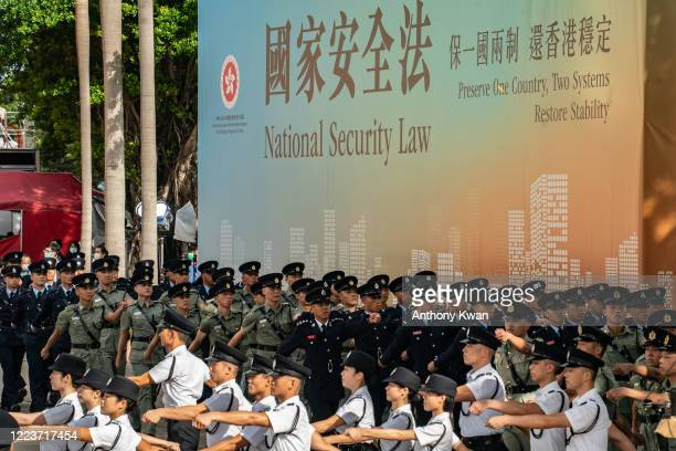 Hong Kong Police guard of honour march after a flagraising ceremony at Golden Bauhinia Square on July 1 2020 in Hong Kong China Hong Kong marks the...