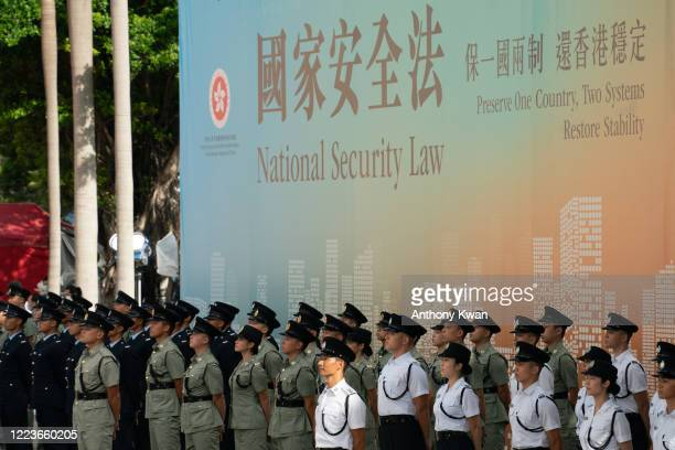Hong Kong Police guard of honour stand at attention during a flagraising ceremony at Golden Bauhinia Square on July 1 2020 in Hong Kong China Hong...