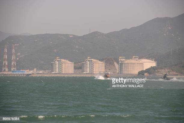 Hong Kong Police sail past nuclear reactors of the Daya Bay Nuclear Power Plant as part of an interdepartmental Daya Bay Contingency Plan nuclear...
