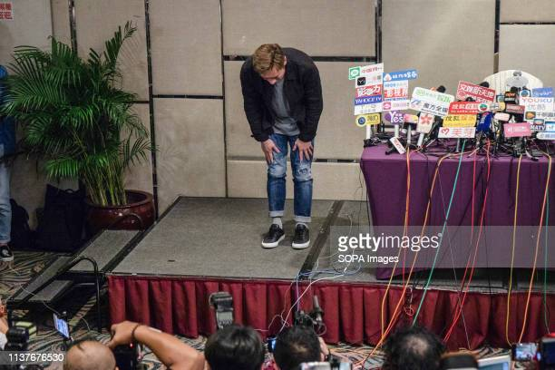 Hong Kong pop star Andy Hui Chion bows to the press at a press conference to address a scandal between him and the local actress Jacqueline Wong...