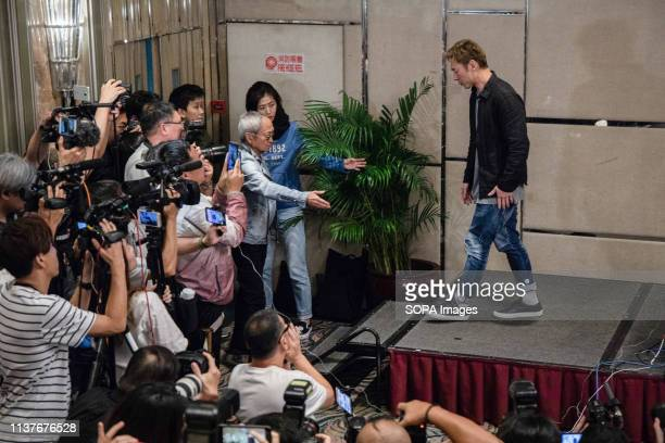 Hong Kong pop star Andy Hui Chion seen leaving a press conference to address a scandal between him and the local actress Jacqueline Wong Sumwing...