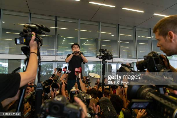 Hong Kong pro-democracy activist, Joshua Wong, speaks to protesters after being released from jail, at a march against a now suspended extradition...