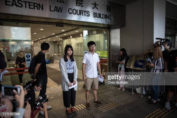 Hong Kong pro-democracy activists Agnes Chow and Joshua Wong speak to the media after being arrested and released on bail on August 30, 2019 in Hong...