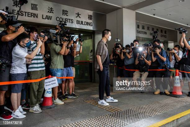 Hong Kong pro-democracy Cantopop singer Anthony Wong arrives at eastern district court in Hong Kong on August 5 after he was arrested by Hong Kongs...