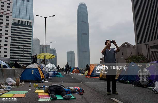 Hong Kong pro-democracy protesters rest during a sit-in as police clear the main protest site in the Admiralty district in Hong Kong on December 11,...