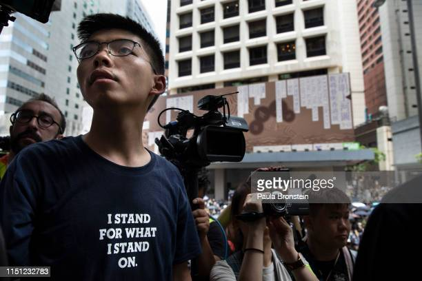 Hong Kong protest leader Joshua Wong speaks as thousands of protesters surround the police headquarter in Hong Kong on June 21 2019 The protests...