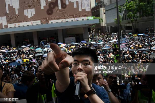 Hong Kong protest leader Joshua Wong speaks as thousands of protesters surround the police headquarter in Hong Kong on June 21, 2019. The protests...