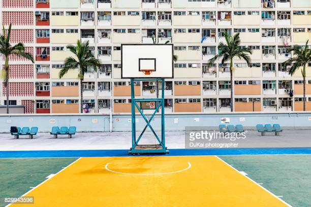 hong kong rainbow village basketball court - courtyard stock pictures, royalty-free photos & images