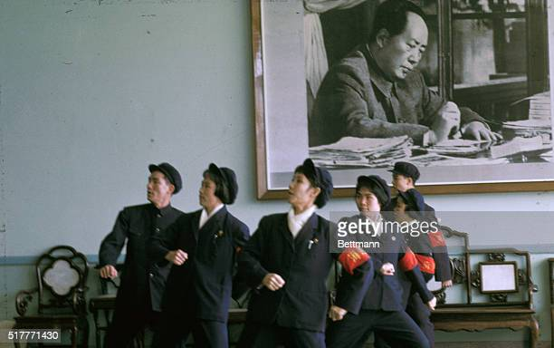 Red Guards singing 'Long LivetoMao's Thought' songs of Mao's thought with background of Mao's portrait