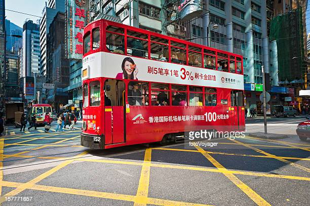 Hong Kong red tram crowded with passengers