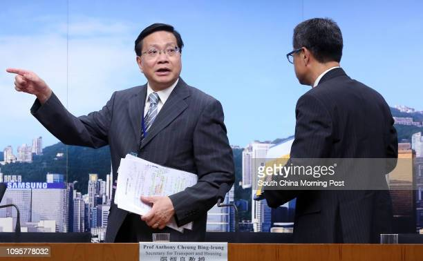Hong Kong Secretary for Transport and Housing Anthony Cheung Bingleung and Secretary for Development Paul Chan Mopo attend a press conference on...