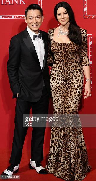 Hong Kong singer and actor Andy Lau and Italian actress Monica Bellucci attend the Cartier Tank Wrist watch event on July 7 2012 in Shanghai China