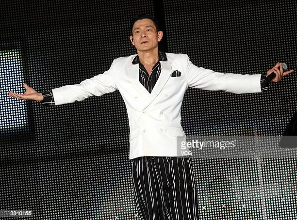 Hong Kong singer Andy Lau performs on the stage at his concert at Shanghai Stadium on May 7 2011 in Shanghai China