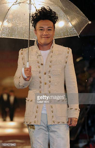 Hong Kong singer Eason Chan poses for a photo as he arrives at the 21st Golden Melody Awards in Taipei on June 26 2010 Musicians from Taiwan Hong...