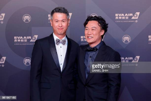 Hong Kong singer Eason Chan poses with Jerald Chan from Hong Kong for a photo upon arrival for the 29th Golden Melody Awards in Taipei on June 23...