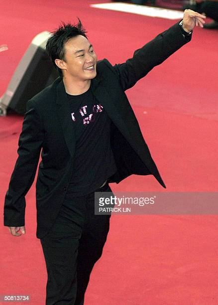 Hong Kong singer Eason waves to the crowd as he arrives at the 15th annual Golden Melody Awards in Taipei 08 May 2004 The Golden Melody Awards are...