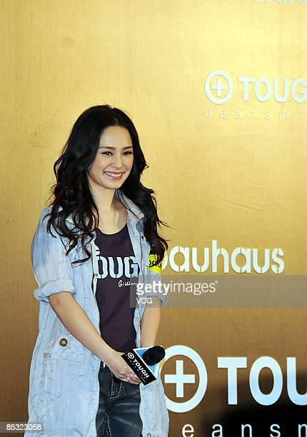 Hong Kong singer Gillian Chung of the popular female music group Twins poses for photographers during the promotional event for a fashion brand on...