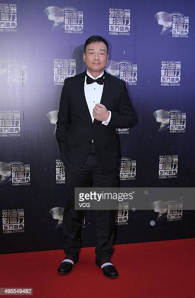 Hong Kong singer, host and actor Wong He arrives at the red carpet of the 2015 Asian Influence Award Oriental Ceremony at Beijing Workers' Gymnasium...