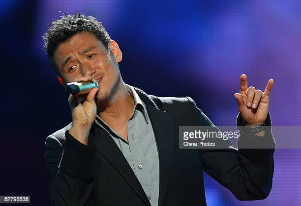 Hong Kong singer Jacky Cheung performs during a concert marking the 52nd birthday of the late Hong Kong pop singer and actor Leslie Cheung September...