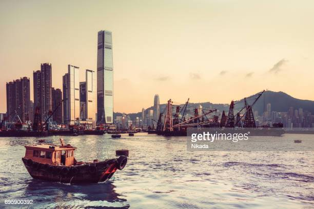 hong kong skyline and fishing boats - hong kong victoria harbour stock pictures, royalty-free photos & images