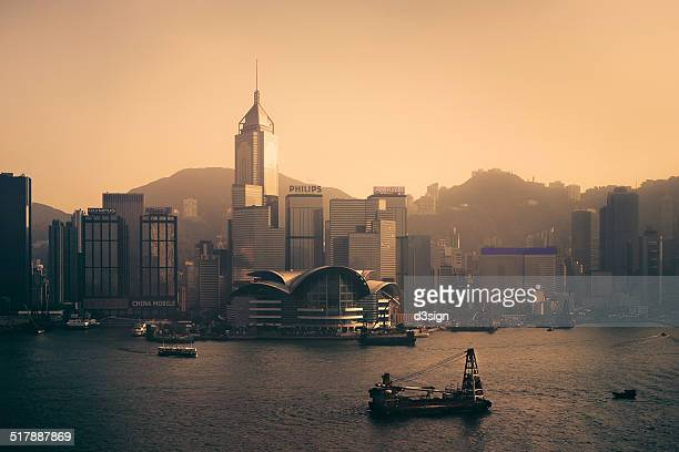 hong kong skyline and victoria harbour at dusk - star ferry stock pictures, royalty-free photos & images
