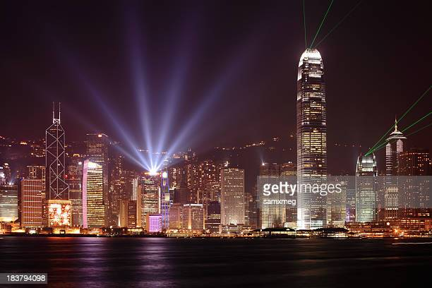 Hong Kong skyline at night with bright beams of light
