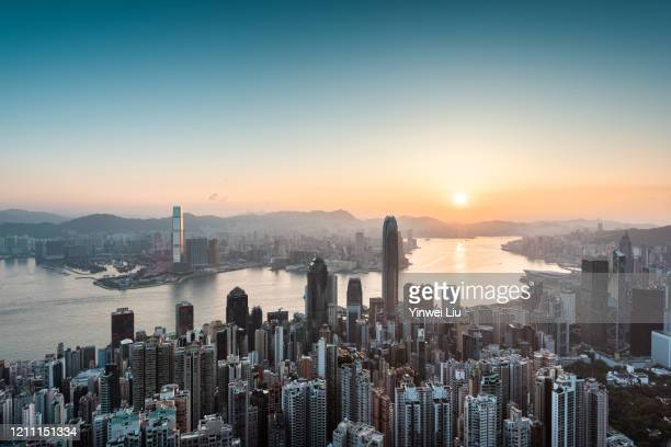 hong kong skyline at sunrise - hong kong stock pictures, royalty-free photos & images