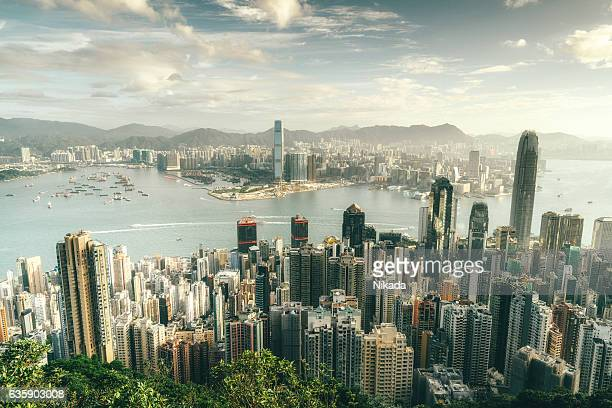hong kong skyline at sunrise - kowloon peninsula stock pictures, royalty-free photos & images