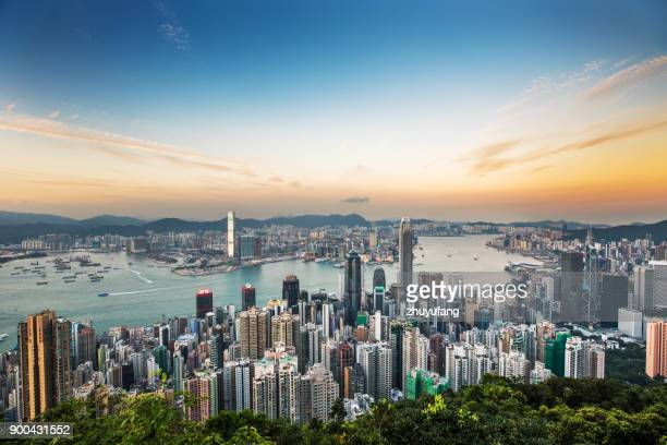 hong kong skyline at sunset - hong kong stock pictures, royalty-free photos & images