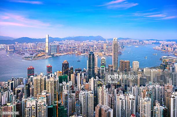 hong kong skyline at twilight - hong kong stock pictures, royalty-free photos & images