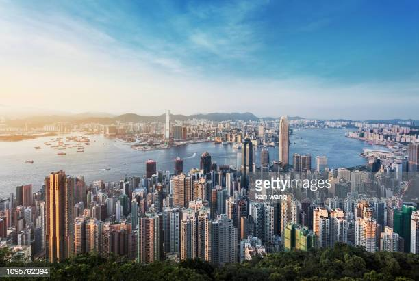 hong kong skyline china - east asia skyscraper cityscape day victoria harbour - hong kong ship sunset futuristic island architecture asia blue city cloud - sky cloudscape development district downtown dusk famous place harbour hong kong island horizontal - hong kong fotografías e imágenes de stock
