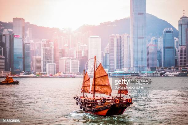 hong kong skyline with chinese boat. - hong kong stock pictures, royalty-free photos & images