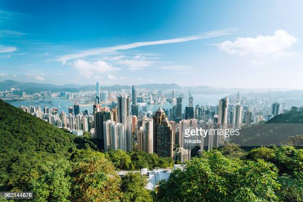 hong kong skyline with clouds - kowloon peninsula stock pictures, royalty-free photos & images