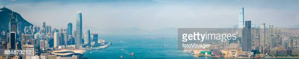 hong kong skyscrapers overlooking aerial panorama of victoria harbour china - tsim sha tsui stock pictures, royalty-free photos & images