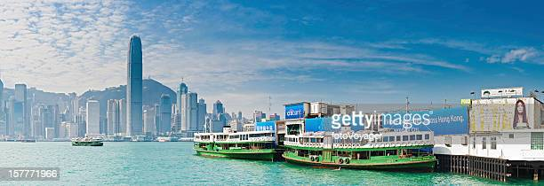 hong kong star ferry terminal harbour skyscraper skyline panorama china - star ferry stock photos and pictures
