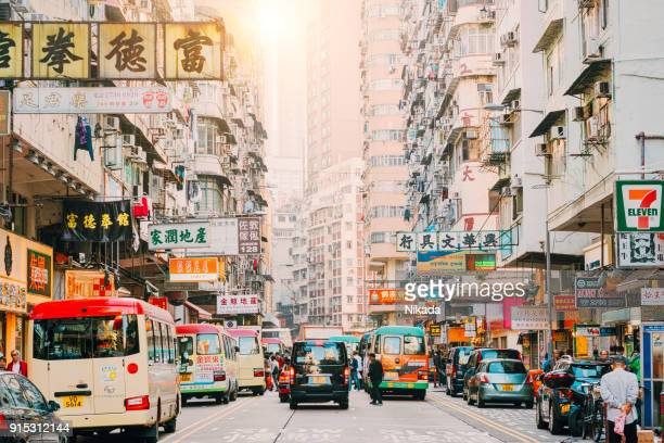 hong kong street scene, mongkok district with traffic - hong kong stock pictures, royalty-free photos & images