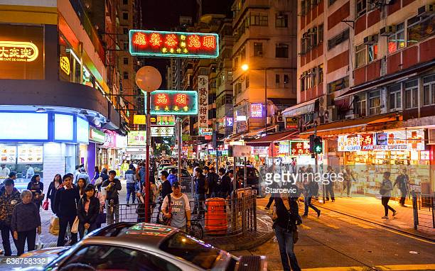hong kong street scene with neon signs at night - wanchai stock photos and pictures