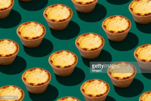 hong kong style egg tart arrangement pattern - abundance stock pictures, royalty-free photos & images