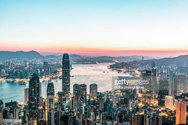 hong kong sunrise - skyline stock pictures, royalty-free photos & images