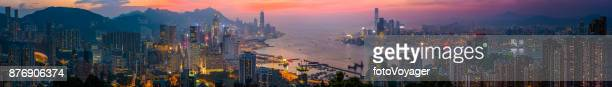 hong kong sunset skyscrapers panorama over victoria harbour kowloon china - kowloon peninsula stock pictures, royalty-free photos & images