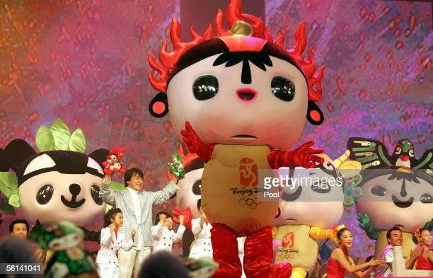 Hong Kong superstar Jackie Chan dances with the mascots for the 2008 Olympic Games during a ceremony to unveil Beijing 2008 Olympic mascots on...