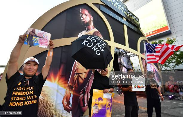 Hong Kong supporters protest outside Staples Center ahead of the Lakers vs Clippers NBA season opener in Los Angeles on October 22 2019 Activists...