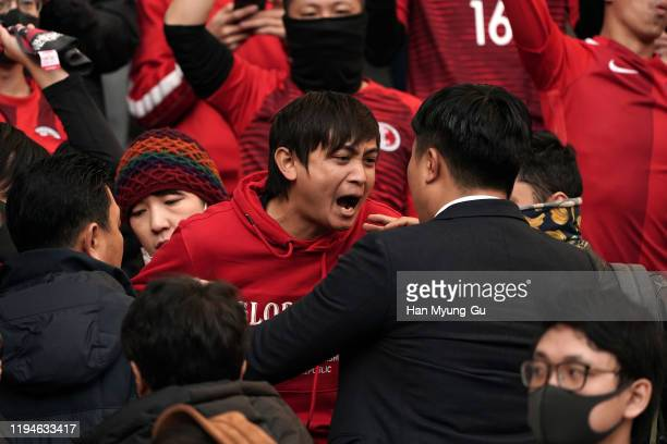 Hong Kong supporters surrounded by security guards during the EAFF E-1 Football Championship match between Hong Kong and China at Busan Asiad Main...