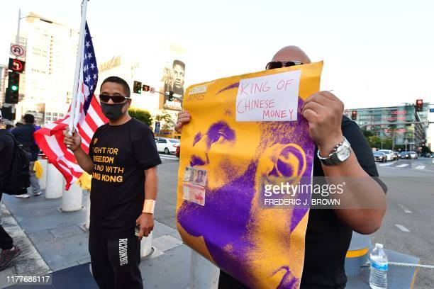 Hong Kong supportes hold signs outside the Staples center ahead of the Lakers vs Clippers NBA season opener in Los Angeles on October 22 2019...